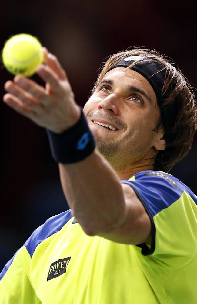 David Ferrer of Spain serves the ball to Lukas Rosol of the Czech Republic during their second round match, at the Paris Masters tennis at Bercy Arena in Paris, France, Wednesday, Oct. 30, 2013