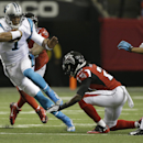 This Dec. 29, 2013, file photo, shows Carolina Panthers quarterback Cam Newton (1) running against the Atlanta Falcons during the second half of an NFL football game, in Atlanta. Newton will have his hands full when the NFC South champion Panthers report
