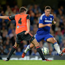 Chelsea's Fernando Torres, right, vies for the ball with Real Sociedad's Gorka Elustondo, during their pre-season friendly soccer match, at Stamford Bridge, in London. Tuesday Aug. 12, 2014