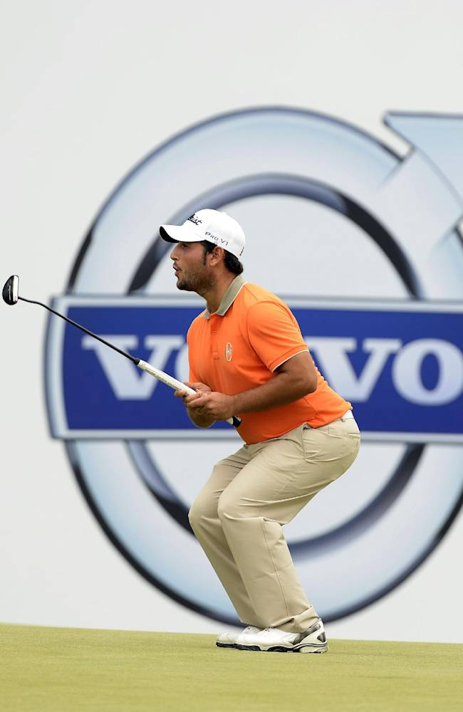 In this photo released by OneAsia, Alexander Levy of France  plays a shot during the second round of the Volvo China Open at Genzon Golf Club in Shenzhen, southern China Friday, April 25, 2014