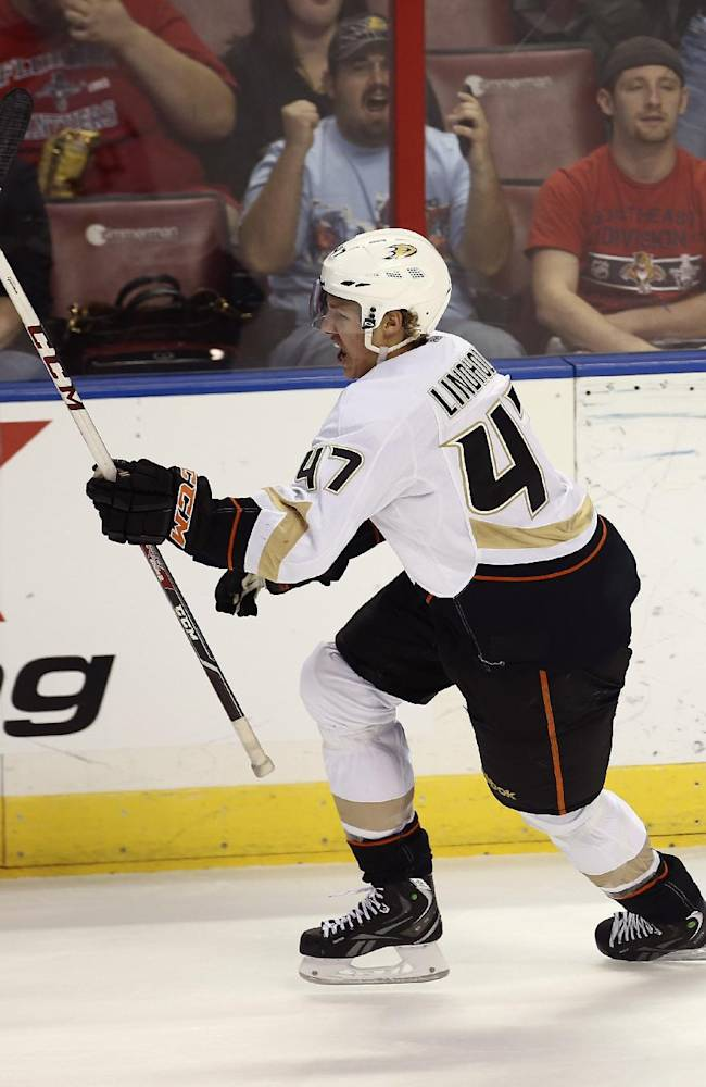 Anaheim Ducks' Hampus Lindholm celebrates after scoring a goal against the Florida Panthers during the first period of an NHL hockey game in Sunrise, Fla., Tuesday, Nov. 12, 2013