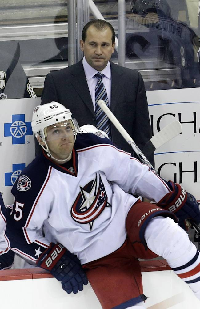 Columbus Blue Jackets coach Todd Richards stands behind his bench as Mark Letestu (55) climbs over the boards in the first period of an NHL hockey game against the Pittsburgh Penguins in Pittsburgh on Friday, Nov. 1, 2013. The Penguins won 4-2