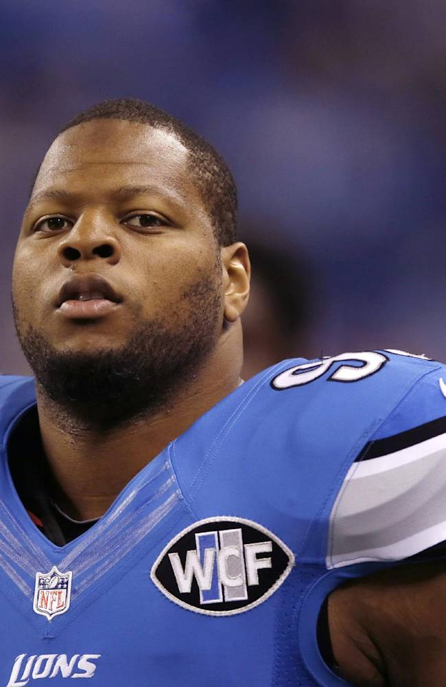 This Sept. 21, 2014, file photo shows Detroit Lions defensive tackle Ndamukong Suh during warm-ups before an NFL football game against the Green Bay Packers in Detroit. Suh can become a free agent after this season, and there's already talk he could be headed elsewhere, but that doesn't seem to be a distraction for the Lions