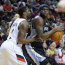 Memphis Grizzlies' Zach Randolph (50) looks to pass against Portland Trail Blazers' Wesley Matthews (2) during the first half of an NBA basketball game in Portland, Ore., Sunday March 30, 2014 The Associated Press