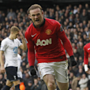 This is a Sunday, Dec. 1, 2013 file photo of Manchester United's Wayne Rooney as he celebrates his penalty goal against Tottenham Hotspur during their English Premier League soccer match at White Hart Lane. The new English Premier League season starts on