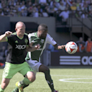 Seattle Sounders Chad Barrett, left, vies for control of the ball against Portland Timbers Steve Zakuani during an MLS soccer match in Portland, Ore., Sunday, Aug. 24, 2014. The Sounders won the game 4 to 1 The Associated Press