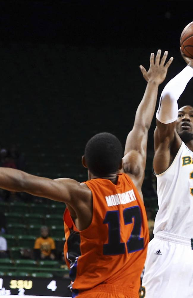 Baylor forward Cory Jefferson (34) shoots over Savannah State forward Joshua Montgomery during the first half of an NCAA college basketball game, Friday, Jan. 3, 2014, in Waco, Texas