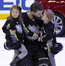 Team Foligno's Brent Burns of the San Jose Sharks gets a kiss from his son after bringing his son and daughter onto the ice at the conclusion of the NHL All-Star hockey game in Columbus, Ohio, Sunday, Jan. 25, 2015. Team Toews won 17-12 The Associated Pr