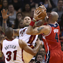 Miami Heat's Shane Battier (31) and Chris Andersen (11) battle Washington Wizards' Marcin Gortat (4) for the ball during the first half of an NBA basketball game in Miami, Monday, March 10, 2014 The Associated Press