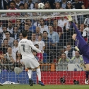 A shot from Real Madrid's Gareth Bale loops over Manchester City's goalkeeper Joe Hart for the opening goal during the Champions League semifinal second leg soccer match between Real Madrid and Manchester City at the Santiago Bernabeu stadium in M