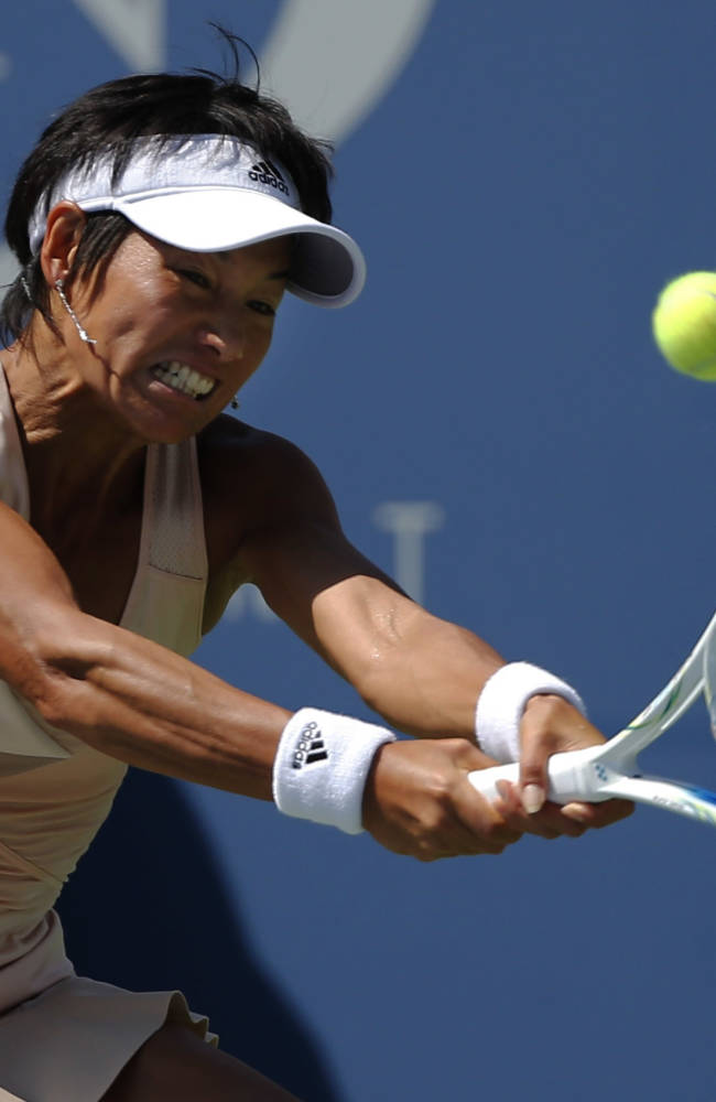 Kimiko Date-Krumm, of Japan, returns a shot against Venus Williams, of the United States, during the opening round of the 2014 U.S. Open tennis tournament, Monday, Aug. 25, 2014, in New York