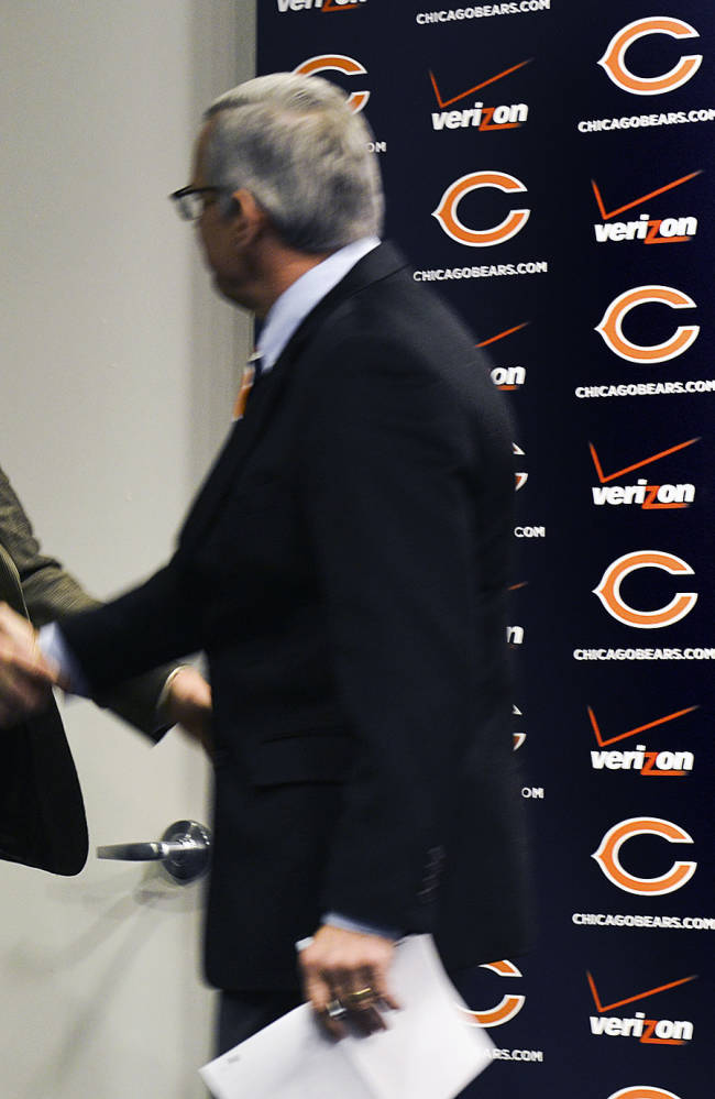 New Chicago Bears NFL football player Jared Allen, left, is greeted by Bears general manager Phil Emery at a news conference where Allen was introduced Monday, March 31, 2014, in Lake Forest, Ill