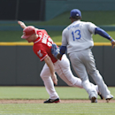 Cincinnati Reds' Jay Bruce (32) is tagged out between second and third by Los Angeles Dodgers shortstop Hanley Ramirez (13) after an RBI single by Joey Votto in the first inning during a baseball game, Saturday, Sept. 7, 2013, in Cincinnati. (AP Photo/David Kohl)