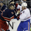 New York Rangers left wing Tanner Glass (15) and Montreal Canadiens right wing Brandon Prust (8) fight during the first period of the NHL hockey game Thursday, Jan. 29, 2015 at Madison Square Garden in New York The Associated Press