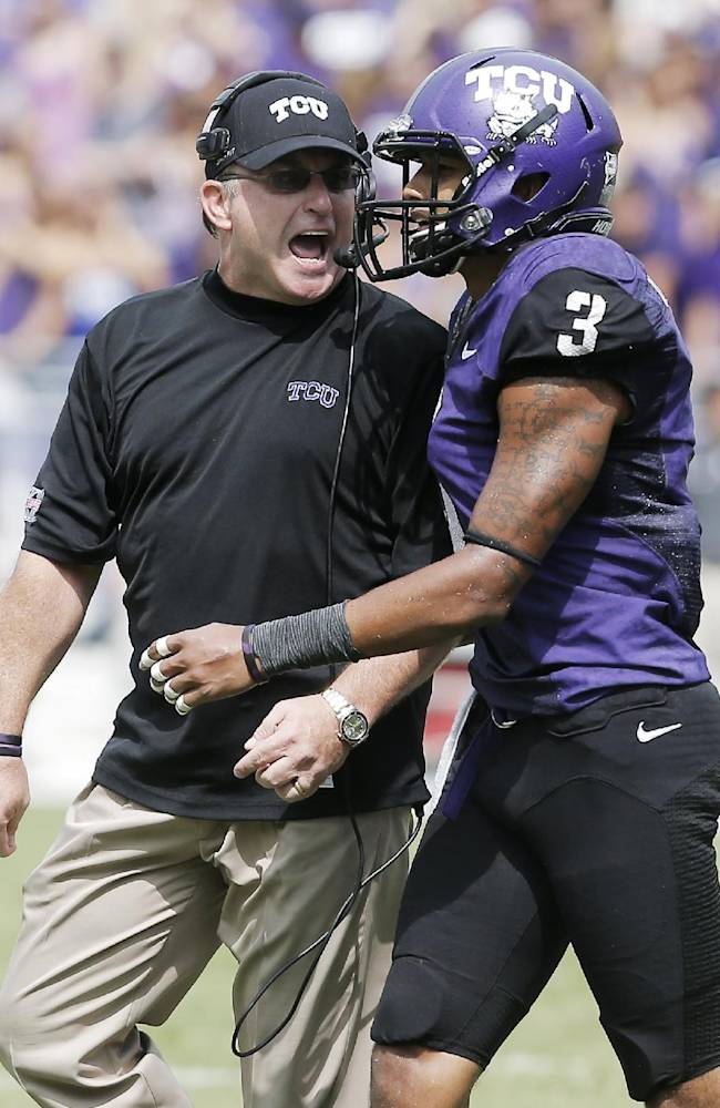 TCU head coach Gary Patterson, left,  gives wide receiver Brandon Carter (3) an ear full after he was called for unsportsmanlike conduct during the second half of an NCAA college football game against SMY Saturday, Sept. 28, 2013, in Fort Worth, Texas. TCU won 48-17