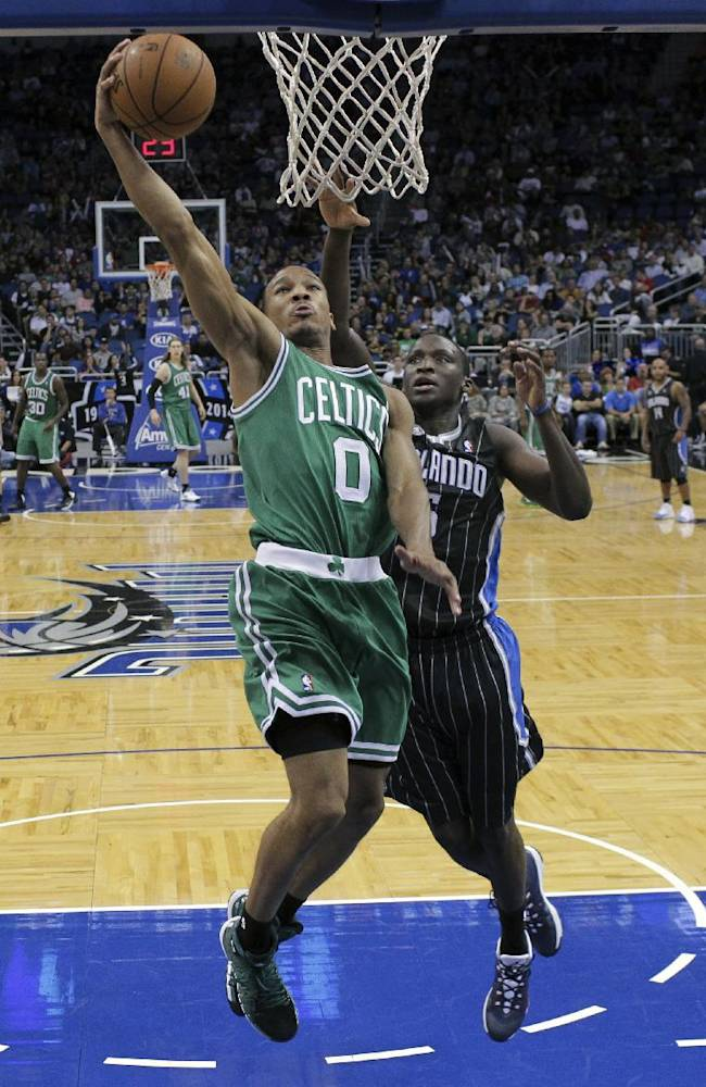 Boston Celtics' Avery Bradley (0) scores a basket in front of Orlando Magic's Victor Oladipo during the second half of an NBA basketball game in Orlando, Fla., Friday, Nov. 8, 2013