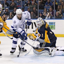Buffalo Sabres' Jhonas Enroth (1), of Sweden, and Josh Gorges (4) defend the net against Tampa Bay Lightning's Ryan Callahan (24) during the third period of an NHL hockey game Tuesday, Dec. 2, 2014, in Buffalo, N.Y. Buffalo defeated Tampa Bay 2-1 The Asso