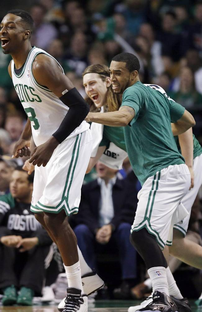 Boston Celtics' Jeff Green, left, reacts after making a basket in the second quarter of an NBA basketball game against the Cleveland Cavaliers in Boston, Saturday, Dec. 28, 2013