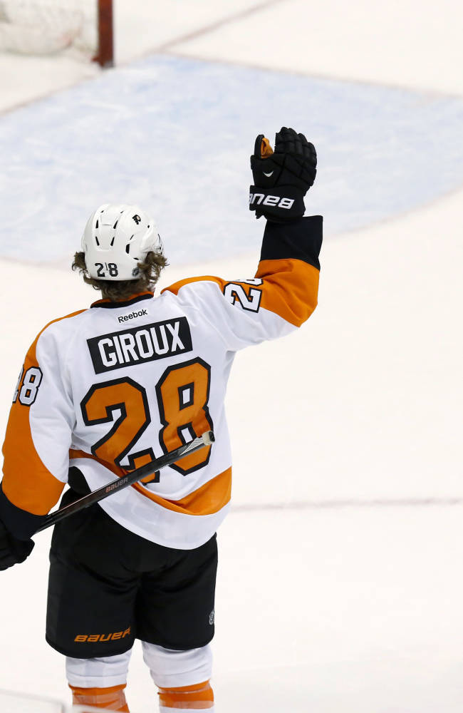 Philadelphia Flyers' Jakub Voracek (93), of the Czech Republic, skates in to give teammate Claude Giroux a high-five after Grioux scored an empty-net goal against the Phoenix Coyotes during the third period of an NHL hockey game Saturday, Jan. 4, 2014, in Glendale, Ariz. The Flyers defeated the Coyotes 5-3