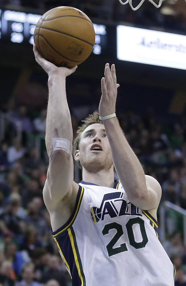 FILE - In this March 24, 2014 file photo, Utah Jazz's Gordon Hayward (20) shoots in the second half during an NBA basketball game against the Detroit Pistons, in Salt Lake City. A person close to the situation says restricted free agent Hayward has agreed to a maximum offer sheet with the Charlotte Hornets that would pay the small forward $63 million over the next four years. The Jazz would have three days to match the deal once Hayward officially signs the offer sheet. The person commented to The Associated Press on condition of anonymity Wednesday, July 9, 2014, because Hayward can't officially sign the offer sheet until Thursday. (AP Photo/Rick Bowmer)