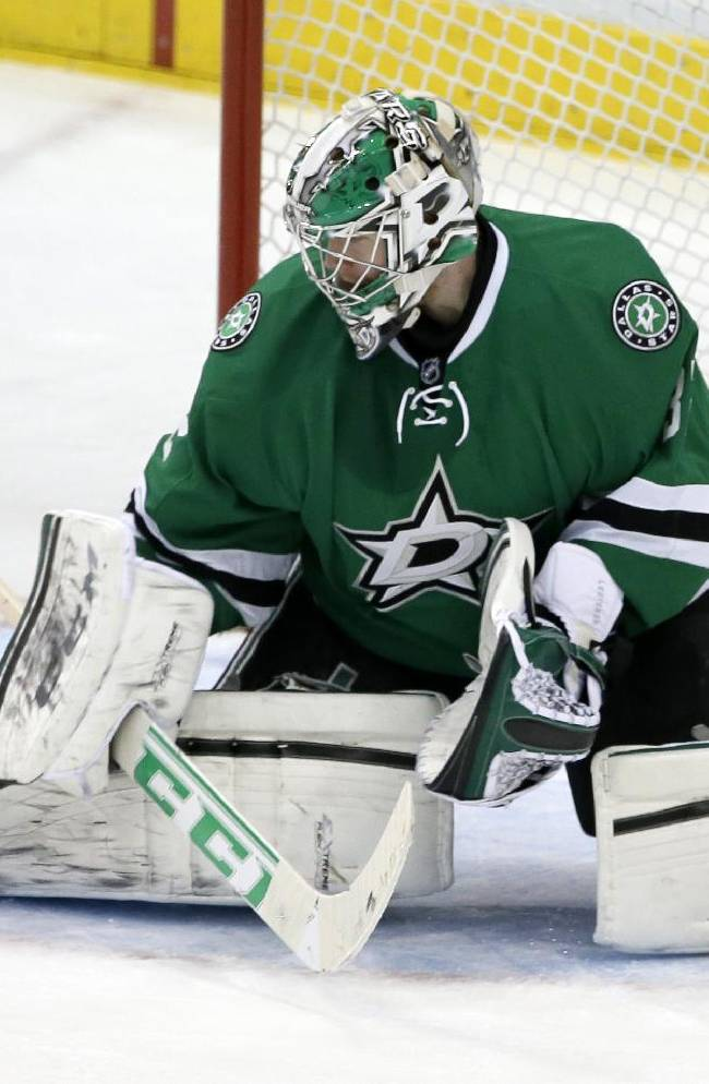 Dallas Stars goalie Kari Lehtonen blocks a shot from the Minnesota Wild in the third period of an NHL hockey game, Tuesday, Jan. 21, 2014, in Dallas. Lehtonen made 18 saves as Dallas (22-20-8) won for the second time in its last 11 games