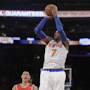 New York Knicks' Carmelo Anthony (7) shoots a 3-point basket as Houston Rockets' Jeremy Lin (7) watches during the first half of an NBA basketball game Thursday, Nov. 14, 2013, in New York The Associated Press