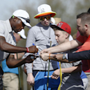 Arizona Cardinals' Patrick Peterson signs his autograph for Scotty and CJ Shaver at the pro-am for the Phoenix Open golf tournament at TPC Scottsdale on Wednesday, Jan. 28, 2015, in Scottsdale, Ariz. (AP Photo/The Arizona Republic, Rob Schumacher)