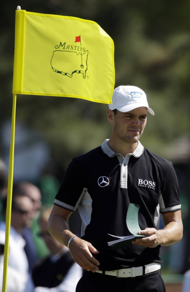 Martin Kaymer, of Germany, takes notes on the seventh green during a practice round for the Masters golf tournament Wednesday, April 9, 2014, in Augusta, Ga
