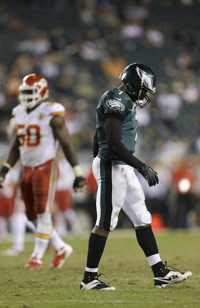 Philadelphia Eagles' Michael Vick, walks off the field after fumbling the ball in the final minutes of an NFL football game against the Kansas City Chiefs, Thursday, Sept. 19, 2013, in Philadelphia. Kansas City won 26-16