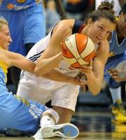 Connecticut Sun's Kelsey Griffin, center, is pressured by Chicago Sky defenders Courtney Vandersloot, left, and Epiphanny Prince during the second half of a WNBA basketball game in Uncasville, Conn., Sunday, Aug. 26, 2012. Chicago won 82-70. (AP Photo/Jessica Hill)