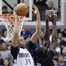 Dallas Mavericks forward Brandan Wright (34) rebounds against Minnesota Timberwolves center Gorgui Dieng (5) during the first half an NBA basketball game Wednesday, March 19, 2014, in Dallas The Associated Press