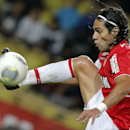 This is a Friday, Nov. 8, 2013 file photo of Monaco's Radamel Falcao of Colombia as he controls the ball during his French League One soccer match against Evian, in Monaco stadium. Radamel Falcao is set to join Manchester United on loan after the Premi