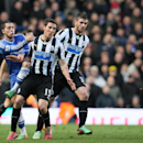 Chelsea's Eden Hazard, left, gets his pass away as Newcastle's Dan Gosling, center and teammate Davide Santon pressure him during their English Premier League soccer match between Chelsea and Newcastle United in London, Saturday, Feb. 8, 2014