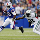 Buffalo Bills running back C.J. Spiller (28) eludes New York Jets cornerback Antonio Cromartie (31) during the first half of an NFL football game on Sunday, Nov. 17, 2013, in Orchard Park, N.Y The Associated Press