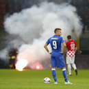 Italy's Simone Zaza , left and his teammate Ciro Immobile wait as a firefighter removes a flare from the field of play during the Euro 2016 qualifying soccer match between Italy and Croatia, at the San Siro stadium in Milan, Italy, Sunday, Nov. 16, 2014 T