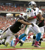 Carolina Panthers quarterback Cam Newton (1) is sacked in the end zone for a safety by Arizona Cardinals defensive end Calais Campbell (93) during the second half of a NFL football game, Sunday, Oct. 6, 2013, in Glendale, Ariz. (AP Photo/Ross D. Franklin)