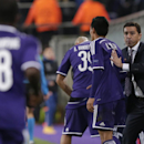Anderlecht's coach Besnik Hasi pats the back of goal scorer Anderlecht's Andy Najar during the Group D Champions League match between Anderlecht and Arsenal at Constant Vanden Stock Stadium in Brussels, Belgium, Wednesday Oct. 22, 2014