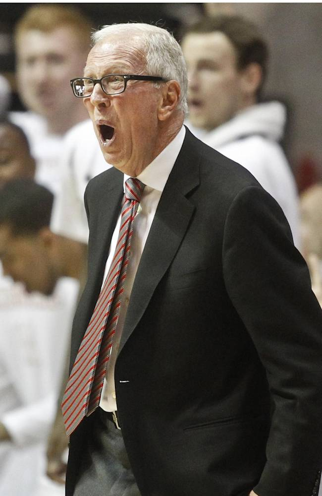 San Diego State coach Steve Fisher gets excited during the second half of a NCAA college basketball game against New Mexico Saturday, March 8, 2014, in San Diego. San Diego State captured the Mountain West Conference regular season championship with a 51-48 victory