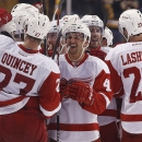 Detroit Red Wings players including Kyle Quincey, Luke Glendening and Brian Lashoff celebrate after defeating the Boston Bruins 4-3 in a shootout in a preseason NHL hockey game in Boston, Saturday, Oct. 4, 2014 The Associated Press