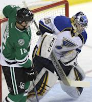 St. Louis Blues goalie Ryan Miller (39) defends the net against Dallas Stars right wing Alex Chiasson (12) during the first period half an NHL hockey game Friday, April 11, 2014, in Dallas. (AP Photo/LM Otero)