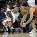 Houston Rockets' Pat Beverley, left, and Milwaukee Bucks' ZaZa Pachulia reach for a loose ball during the first half of an NBA basketball game Saturday, Feb. 8, 2014, in Milwaukee The Associated Press