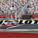 Jimmie Johnson drives past the flag stand during practice for Sunday's NASCAR Sprint Cup series Coca-Cola 600 auto race at Charlotte Motor Speedway in Concord, N.C., Saturday, May 25, 2013. (AP Photo/Chuck Burton)