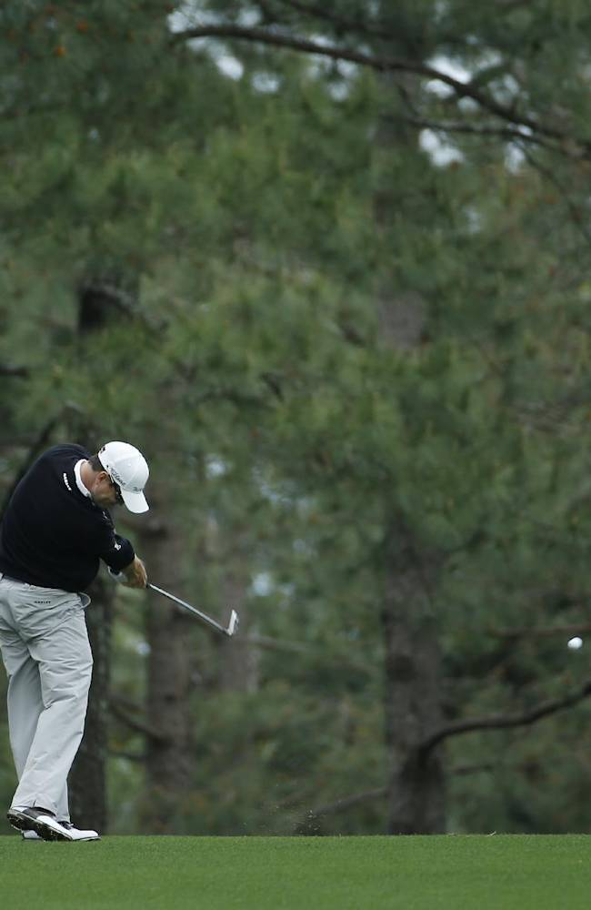 Zach Johnson hits off the first fairway during a practice round for the Masters golf tournament Tuesday, April 8, 2014, in Augusta, Ga