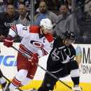 Carolina Hurricanes center Eric Staal, left, and Los Angeles Kings center Anze Kopitar, of Slovenia, vie for the puck during the second period of an NHL hockey game, Saturday, March 1, 2014, in Los Angeles The Associated Press