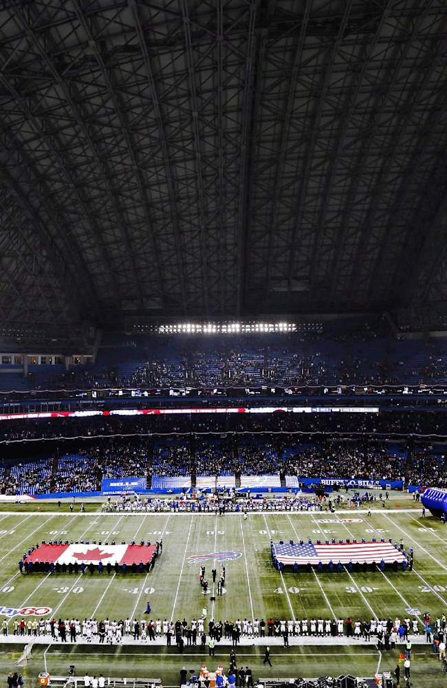 The national anthems of the United States and Canada are played before the Buffalo Bills against the Atlanta Falcons in an NFL football game at Rogers Centre in Toronto, Sunday, Dec. 1, 2013