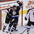 Winnipeg Jets' Bryan Little (18) celebrates Blake Wheeler's (26) goal against Colorado Avalanche's goaltender Semyon Varlamov (1), Erik Johnson (6) and Matt Duchene (9) during first period NHL hockey action in Winnipeg, Manitoba, on Thursday, Dec. 12, 20