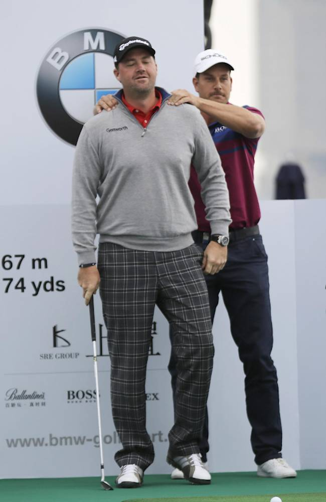 Henrik Stenson of Sweden, right,  jokes with his compatriot and defending champion Peter Hanson during a photo call ahead of the Masters golf tournament in Shanghai, China, Tuesday, Oct. 22, 2013. The Masters will begin on Oct. 24 at the Lake Malaren Golf Club