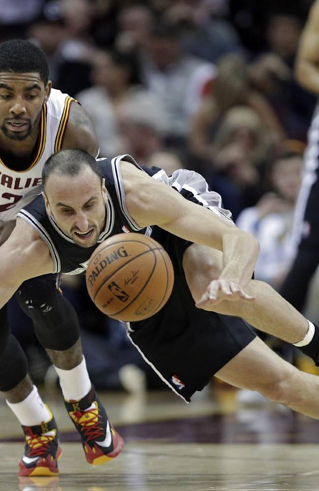 Cleveland Cavaliers' Kyrie Irving, left, and San Antonio Spurs' Manu Ginobili chase down a loose ball during the first quarter of an NBA basketball game Tuesday, March 4, 2014, in Cleveland