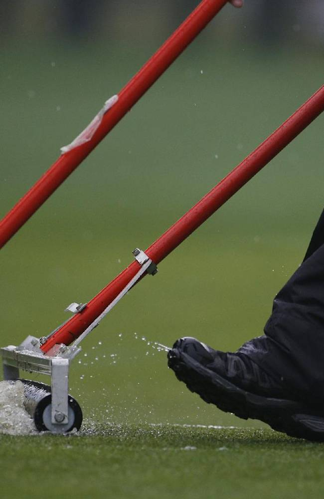 Members of the grounds crew push water off the 12th fairway during the second round of the PGA Championship golf tournament at Valhalla Golf Club on Friday, Aug. 8, 2014, in Louisville, Ky