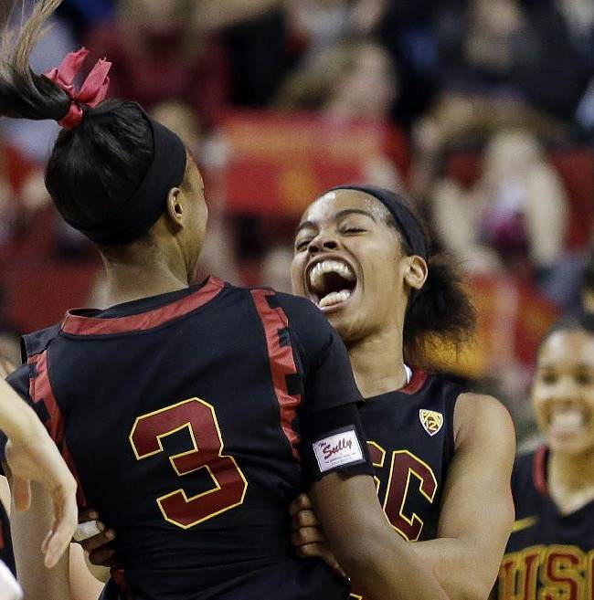 Southern California's Brianna Barrett celebrates with teammates after beating Oregon State in the Pac-12 NCAA college championship basketball game Sunday, March 9, 2014, in Seattle.  USC won 71-62